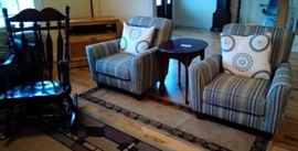 2 arm chairs with pillows, oval wood table