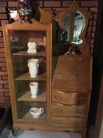 I love this early 1900's secretary with beveled mirror and classic white pottery pieces.