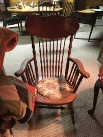 This is an early 1900's oak rocker that has been reupholstered and makes a great accent.