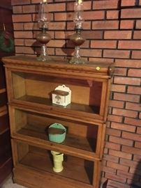 This is a nice five-piece barrister-style bookcase with three sections, top, and bottom.  Notice the two salts and a vase -- nice pieces!