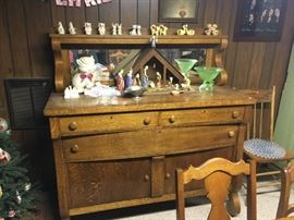 One of two early 1900's sideboards with mirror and accent shelf.  Notice the great collectibles: salt and peppers, depression glass, etc.