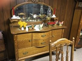 This is the other early 1900's oak sideboards -- note the vintage wood pull toys, cast iron piece, and early hurricane lamp!