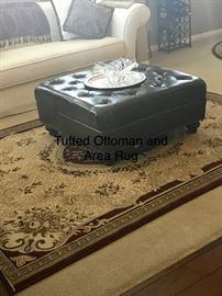 Tufted ottoman and area rug