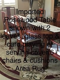 Imported Rosewood dining table set for 6; glass top and card playing covers; 6 cushioned chairs and area rug