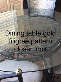 Dining table with gold filigree pattern