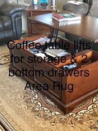 Coffee table lifts display and bottom drawers for storage another area rug