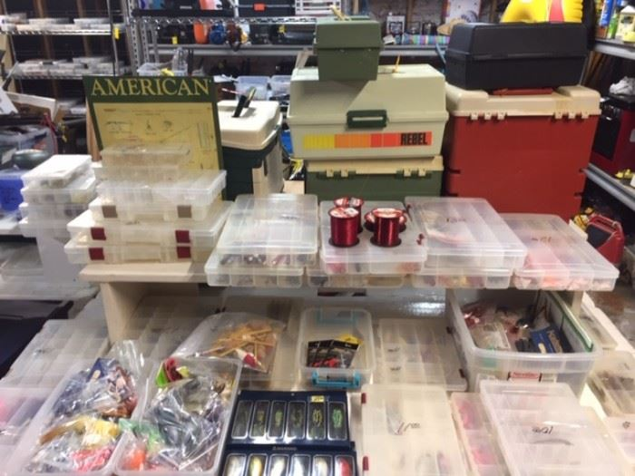 Tables full of fishing LURES and all kinds of fishing gears