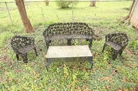 Four piece cast iron antique garden furniture set.