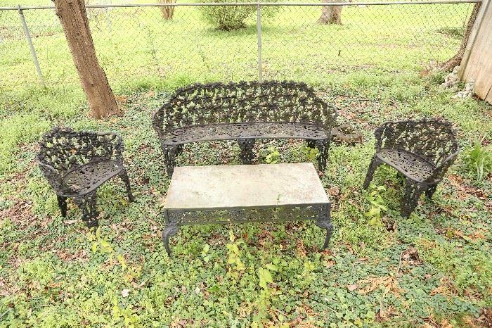 Four piece cast iron antique garden furniture set.