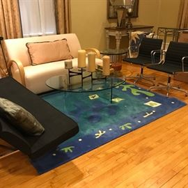 black Eames by Herman Miller sofa and chairs, glass coffee table,  Carter sofa