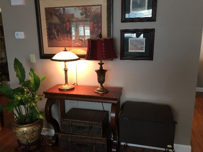 Ballard Designs sofa table $40, 3 framed hunting pictures and picture light $40, red lamp $20, decorative/storage luggage set $15