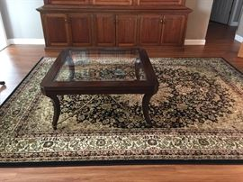 Hooker glass top coffee table, bought new from Sauder Furniture less than 2 years ago $250   Oriental rug. Also bought new under 2 years ago. $300