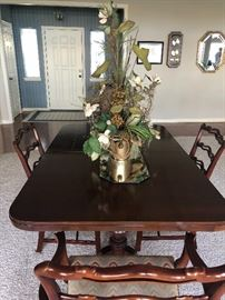 Gorgeous dining table with chairs, leaves and table pads