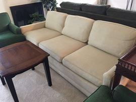 Classic, tailored mid-century sofa.  Off white.