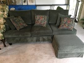 Comfy sofa with matching ottoman and 5 toss pillows.