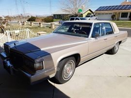 #62: 1990 Cadillac Brougham of Elegance, 5.7l V8 VIN: 1G6DW5471LR717451 Leather interior. Power seats, windows, and mirrors. Tires have plenty of tread!!! Gentlemen had the car for 27 years. And has constantly maintain the beauty. All windows, door locks, breaks are in good condition January 1992  DMV fees: $15 transfer and $70 doc fees