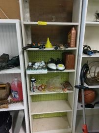 Golf shoes and balls with tees with misc items.  We have golf clubs too!