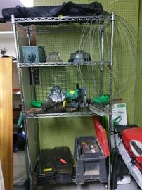 work box with tools, fishing tackle box with a number of lures, lights and saw.
