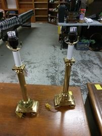 matching gold lamps that look like statues