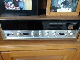 Sansui AM/FM stereo receiver model 5000A. From 1974 - 1976. Rated at 55 watts per channel into 8 ohms. Features, both tuning and signal meters, two tape in/outputs, one phono input, one aux input, high and low filters on/off, muting on/off, FM stereo only on/off, loudness on/off, reverse on/off, mono on/off, selectors - tape head - phono - AM - FM - FM auto - aux, front tape playback and record inputs, separate bass and treble tone controls.