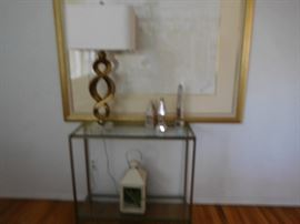 small  glass  top table,  goldtone  lamp  with  lucite  base