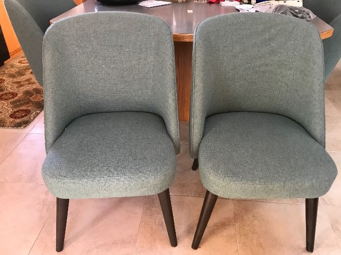 There are eight of these very nice Room and Board chairs available at this estate sale