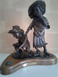 Boy Girl Turtle Sculpture Called Die Diversions