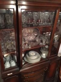 China cabinet with Fostoria glassware and china and assorted other glassware.