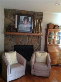 Two swivel accent chairs, secretary desk, framed artwork and home accessories