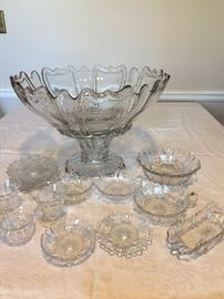 Antique Heisey U.S. Glassware - Old Queen Anne pre-1909.  This pattern is quite an elegant & distinctive design.  Punch bowl does bear the H signature. Pieces may have imperfections like straw marks, bubbles, occlusions that are characteristic of antique pressed glass. There are no chips or scratches noted.