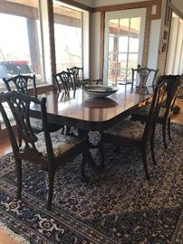 Dining room table  with 8 chairs- two arm chairs included in count.