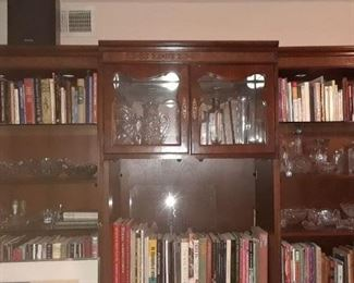 Entertainment center can be used as two book shelves and the center section made into a bar.