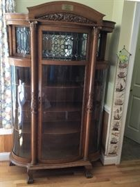 Tiger Oak Breakfront Glass China Cabinet with leaded glass early 1900's with original Key and Casters. This Heirloom Piece is from the  Newell/Oehmig/Stone Family of Chattanooga.