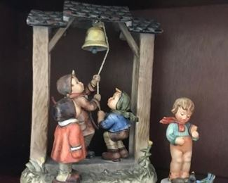 #18Large Hummel's statue of 3 kids ringing a  bell  $80.00  #19lladro girl w bird  and flowers 5217 $34.00