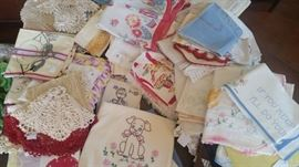 Many different linens = crocheted, embroidered, southwest patterns, tablecloths, dresser scarves, hankies, etc.
