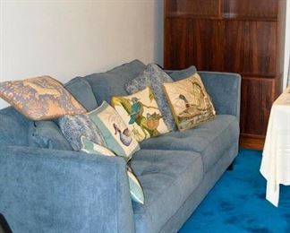 Couch blue fabric and bookshelf