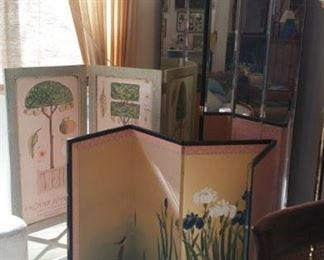 3 different folding screens... far back one in a tall 3 panel mirrored screen