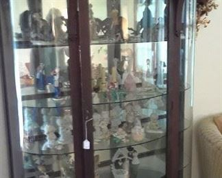 Display cabinet with Precious Moments, German and other collectible figures