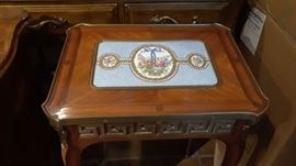 Beautiful porcelain inset design on small side table.