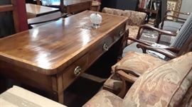 Desk with unusual escheuons. Beautiful wood. Antique.