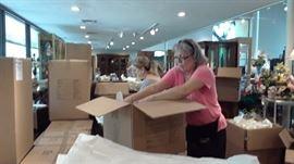 Carla and Rita unpacking