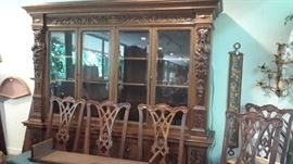 Large carved bookcase has been wired with lighting and can be used as a china cabinet. Shown are Chippendale side chairs. Fifteen are available but we have only five on display. Others can be picked up at UTSA.