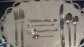 A  view of the various pieces available. 40 knives, forks, and spoons. 40 iced tea spoons, 35 soup spoons, 36 luncheon knives, 32 luncheon forks, 20 fruit spoons, 32 cocktail forks, 6 serving spoons, 39 individual butter knives, and 12 demi tasse spoons.