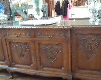 Buffet is nine feet long with fitted glass top, silver flatware dividers