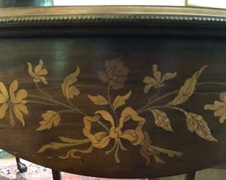 Inlay work appears on several tables and chests