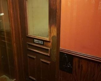 Mens and womens bathroom doors