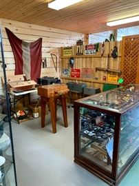Booth with Signs, belt buckles, butcher block, display case loaded