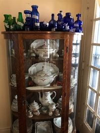 Beautiful antique OK empire China cabinet with incredibly beautiful complete Bavarian China set.