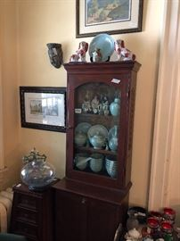 Antique curio packed with Asian collectibles