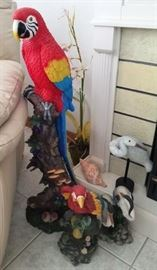 Tall resin colorful Parrots (SOLD) on branches decor. Wood crane on stand. Faux conch shell. Tall artificial orchid.